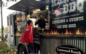 Mobile Catering in Calgary With Ranch BBQ Food Truck - selling food out the window at stampede park